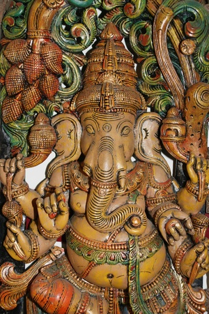 Wooden sculpture of Ganesha, Hindu God of Success photo