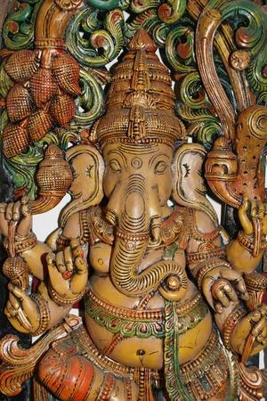 Wooden sculpture of Ganesha, Hindu God of Success photo