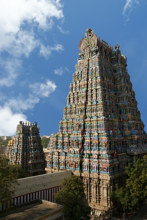 Meenakshi hindu temple in Madurai, Tamil Nadu, South India. Sculptures on Hindu temple gopura (tower). It is a twin temple, one of which is dedicated to Meenakshi, and the other to Lord Sundareswarar
