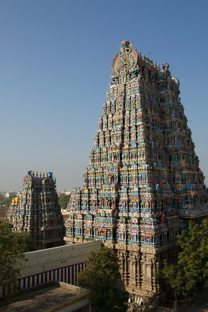 Meenakshi hindu temple in Madurai, Tamil Nadu, South India. Sculptures on Hindu temple gopura (tower). It is a twin temple, one of which is dedicated to Meenakshi, and the other to Lord Sundareswarar Stock Photo - 11340854