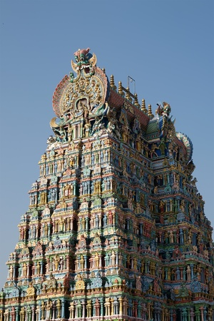 hindu god shiva: Meenakshi hindu temple in Madurai, Tamil Nadu, South India. Sculptures on Hindu temple gopura (tower). It is a twin temple, one of which is dedicated to Meenakshi, and the other to Lord Sundareswarar