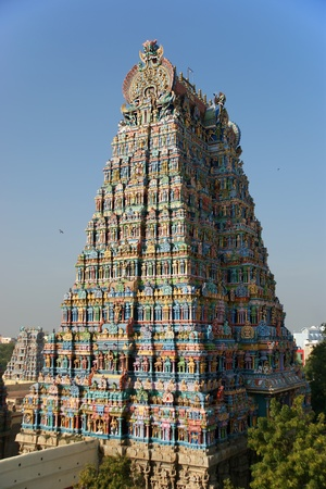temple tower: Meenakshi hindu temple in Madurai, Tamil Nadu, South India. Sculptures on Hindu temple gopura (tower). It is a twin temple, one of which is dedicated to Meenakshi, and the other to Lord Sundareswarar