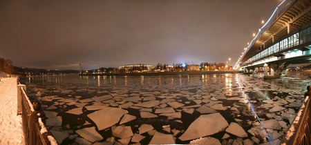 Night panorama of the winter river and a big sports arena of the Olympic Complex Luzhniki, Moscow, Russia photo