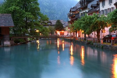 Switzerland, Interlaken. Evening view of a small river in the downtown