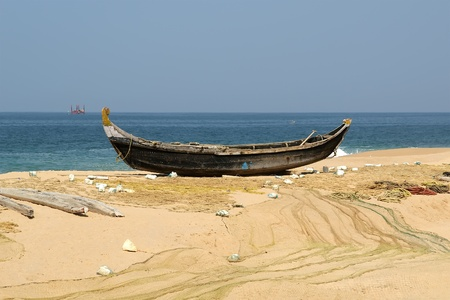 Fishing Net and Boat on the ocean. Kovalam, Kerala, South India photo