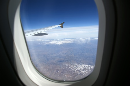 airplane window: Aircraft illuminator window view Stock Photo
