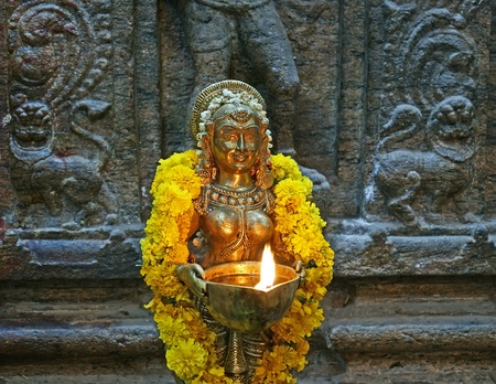 The traditional Hindu religion sculpture. Inside of Meenakshi hindu temple in Madurai, Tamil Nadu, South India. photo