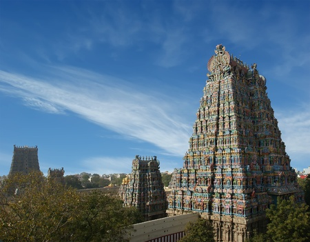 holy god: Meenakshi hindu temple in Madurai, Tamil Nadu, South India. Sculptures on Hindu temple gopura (tower). It is a twin temple, one of which is dedicated to Meenakshi, and the other to Lord Sundareswarar