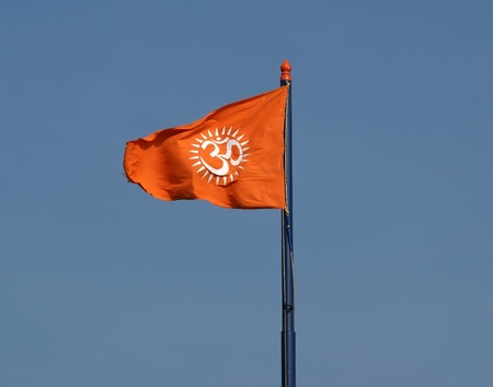 Flag with a sign Om or Aum --is a sacred, mystical syllable in the Dharma or Indian religions, i.e. Hinduism, Jainism, and Buddhism Stock Photo - 11332361