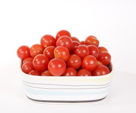 cherry tomato --is a smaller garden variety of tomato, on a white background Stock Photo - 11330339