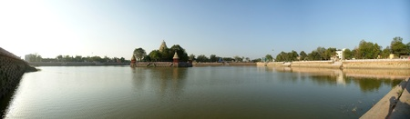 Traditional Hindu temple on lake in the city center, South India, Kerala, Madurai photo