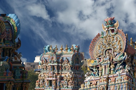 Meenakshi hindu temple in Madurai, Tamil Nadu, South India. Sculptures on Hindu temple gopura (tower). It is a twin temple, one of which is dedicated to Meenakshi, and the other to Lord Sundareswarar Stock Photo - 11328361
