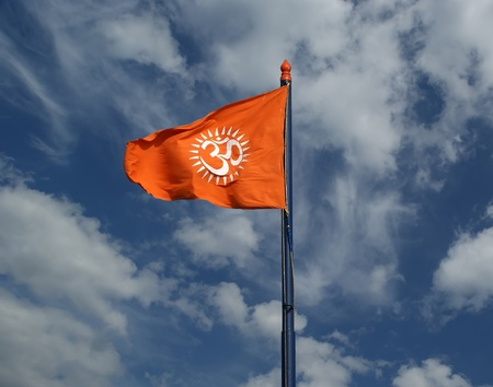 aum: Flag with a sign Om or Aum --is a sacred, mystical syllable in the Dharma or Indian religions, i.e. Hinduism, Jainism, and Buddhism