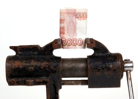 Allegory of the global financial crisis - the Russian Ruble in the grip of economic crisis, on a white background photo