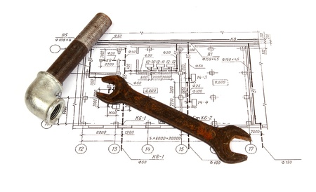 Plumbing parts and tools on the drawing, close-up photo