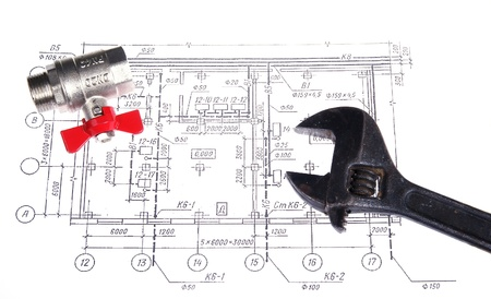 Plumbing parts and tools on the drawing, closeup photo
