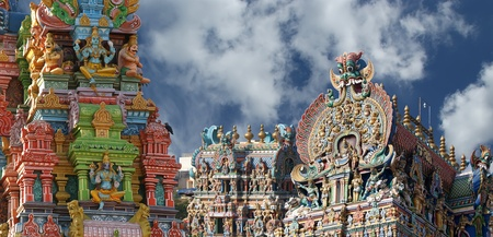 Meenakshi hindu temple in Madurai, Tamil Nadu, South India. Sculptures on Hindu temple gopura (tower). It is a twin temple, one of which is dedicated to Meenakshi, and the other to Lord Sundareswarar Stock Photo - 11320193