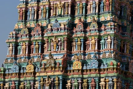Meenakshi hindu temple in Madurai, Tamil Nadu, South India. Sculptures on Hindu temple gopura (tower). It is a twin temple, one of which is dedicated to Meenakshi, and the other to Lord Sundareswarar photo