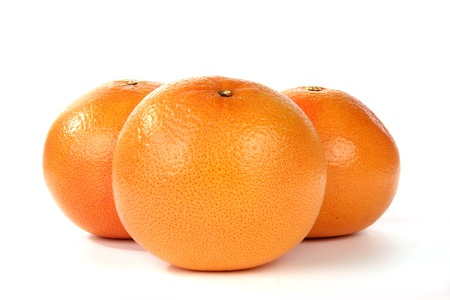 large grapefruits closeup, on white background