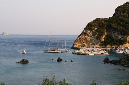 Paleokastritsa, island Corfu, Ionian sea, Greece. Kind on a bay. photo