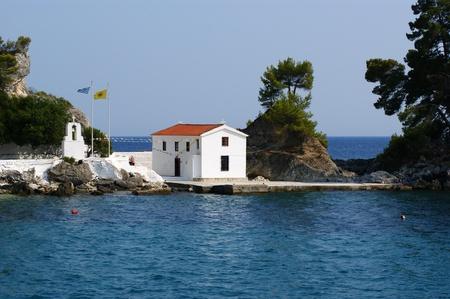 island Corfu, Ionian sea, Greece. Kind on small Catholic church from outside the seas. photo