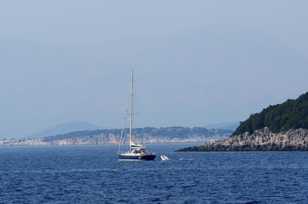 island Corfu, Ionian sea, Greece. Kind at coast from outside the seas. photo