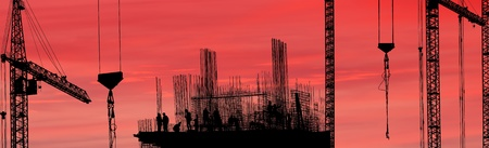 Construction workers silhouette against the sunset., panorama photo