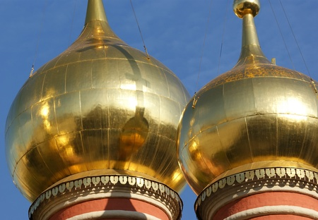 gilding: The big gold domes of orthodox church in city centre Moscow, Russia. Stock Photo