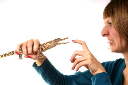 Portrait of a girl in profile with a small crocodile in his hand Stock Photo - 11345267