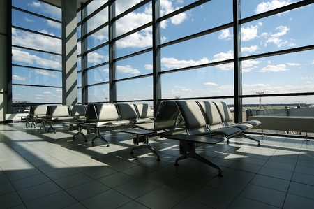 Airport gates, modern architecture of the airport terminal with seats and a huge glass facade of view Editorial
