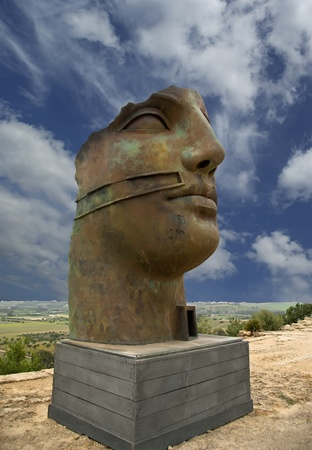 The statue in the archeological area of Agrigento, Sicily, Italy photo