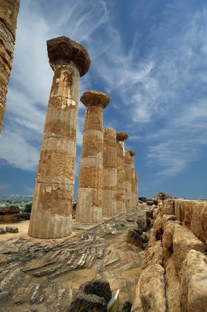 Remains of an ancient Greek temple of Heracles (V-VI century BC), Valley of the Temples, Agrigento, Sicily. The area was included in the Heritage Site list in 1997 photo