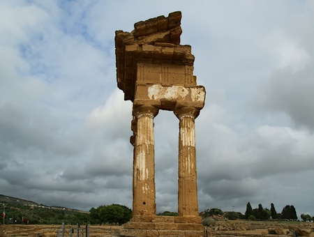 Ancient Greek Temple of the Dioscuri (V-VI century BC), Valley of the Temples, Agrigento, Sicily. The area was included in the UNESCO Heritage Site list in 1997 Stock Photo - 12237011