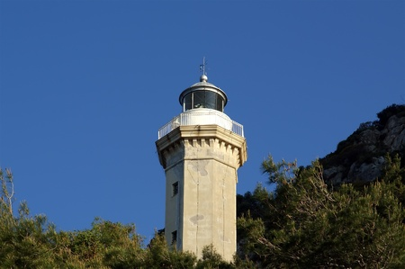 Lighthouse on the coast of the Mediterranean Sea, Sicily, Italy photo