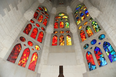 Stained glass window at the entrance of the Sagrada Familia in Barcelona Editorial