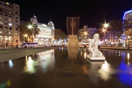 Plaza Catalonia in the Christmas decorations at night. Barcelona, Catalonia, Spain