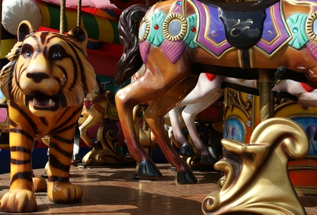 traditional horse ride carousel in a childrens amusement park photo