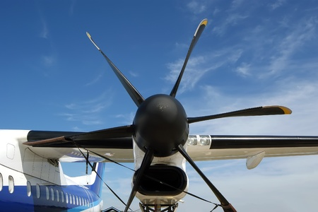 Small plane propeller closeup against blue sky