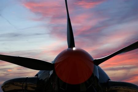 Small plane propeller closeup against blue sky photo