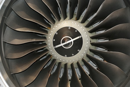Closeup of a jet turbine. Blades of the airplane turbine
