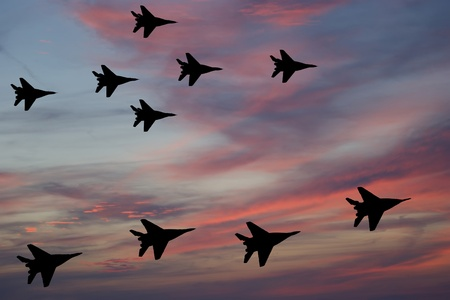 Flight of modern combat fighters on the sky background Stock Photo - 13189835