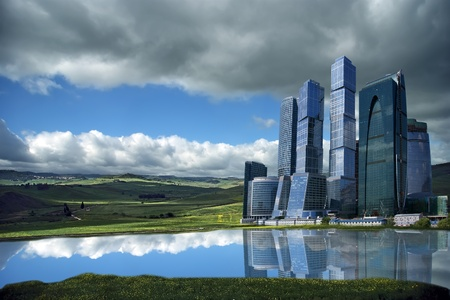 Landscape of skyscrapers in the open field against the background of a stormy sky photo