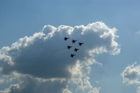 Flight of modern combat fighters on the sky background Stock Photo - 13424653