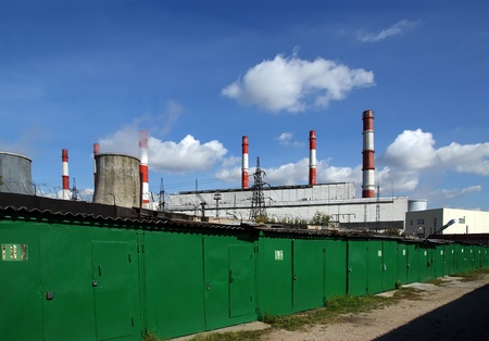 industrial zone of the city with Pipes of coal  burning power station and garages. Moscow, Russia Stock Photo - 13413803
