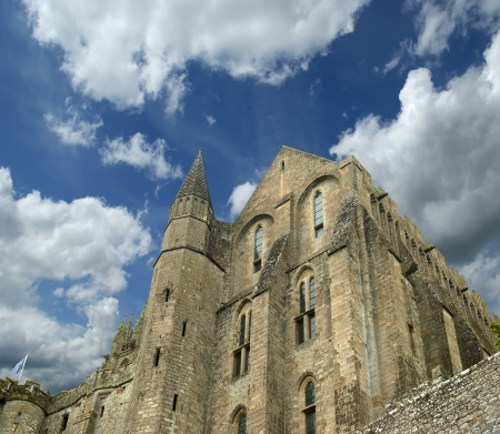 variously: Mont Saint-Michel, Normandy, France--one of the most visited tourist sites in France. Designated as one of the first UNESCO World Heritage Sites in 1979, the site has variously been a stronghold, monastery, prison and historic monument since 1874
