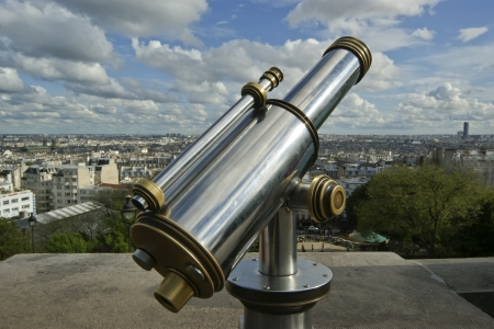 A telescope viewer overlooks view Paris skyline from the Sacre-Cur Basilica, France photo