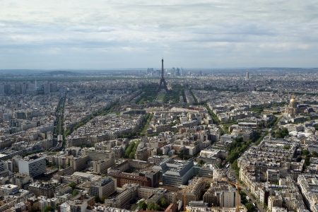 The city skyline at daytime. Paris, France. Taken from the tour Montparnasse with the Eiffel Tower, Le Grande Palais, Les Halles, St. Eustace &amp, La Defense clearly visible  photo