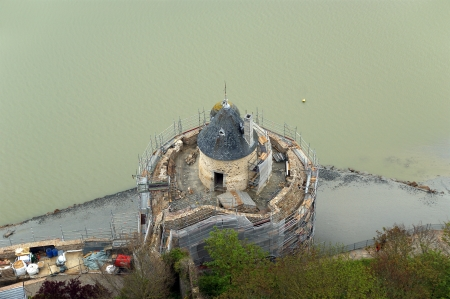 variously: View from Mont Saint-Michel, Normandy, France--one of the most visited tourist sites in France. Designated as one of the first Sites in 1979, the site has variously been a stronghold, monastery, prison and historic monument since 1874