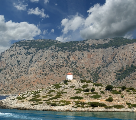 dodecanese: Old windmill on the shore of one of the Greek islands of the Dodecanese in the Aegean Sea, Greece