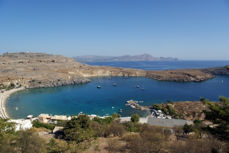 Greece, Rhodes Island, Lindos, view at the acropolis and the popular St.Pauls bay photo